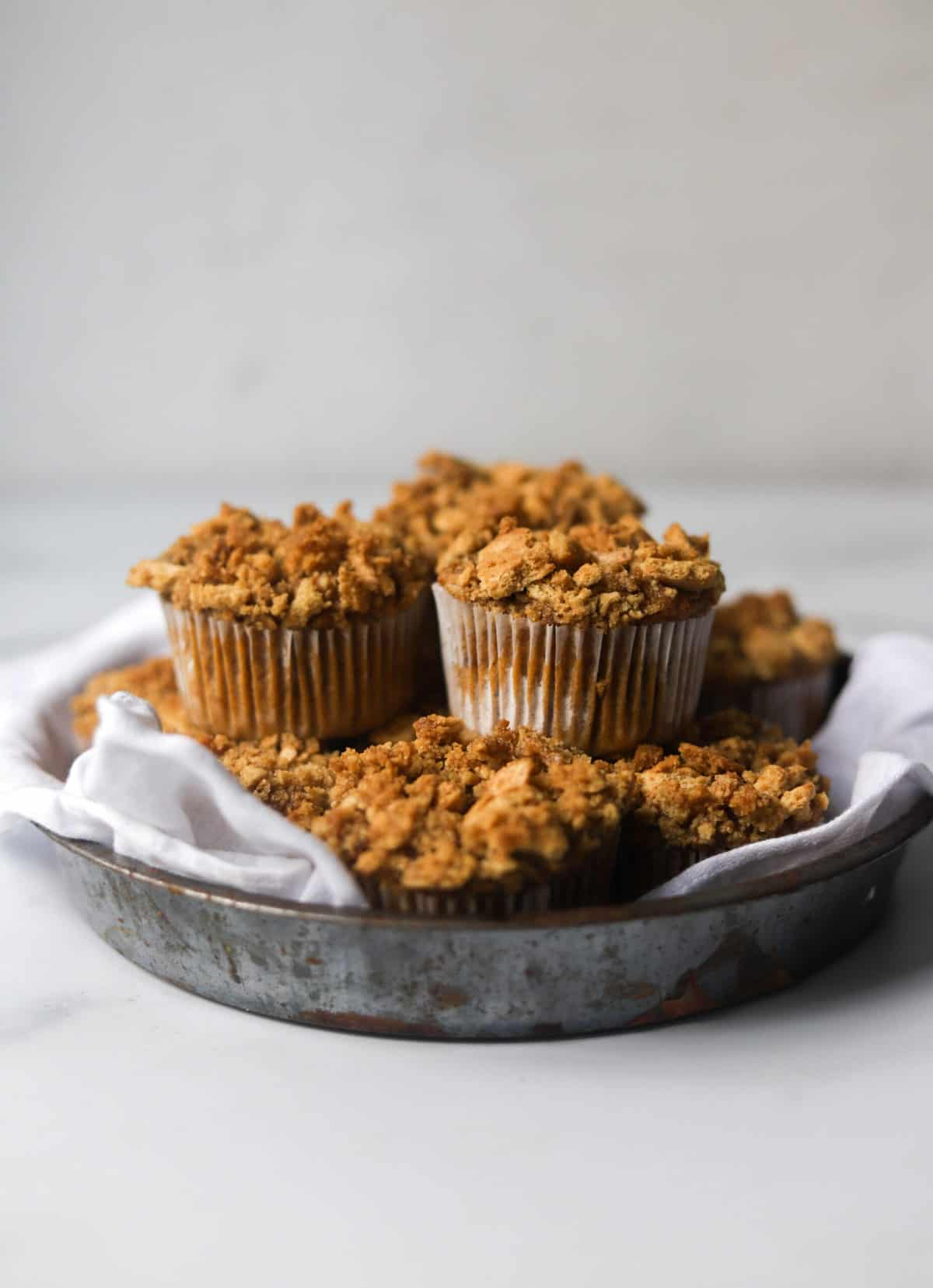 A side shot of a tin filled with sweet potato muffins.