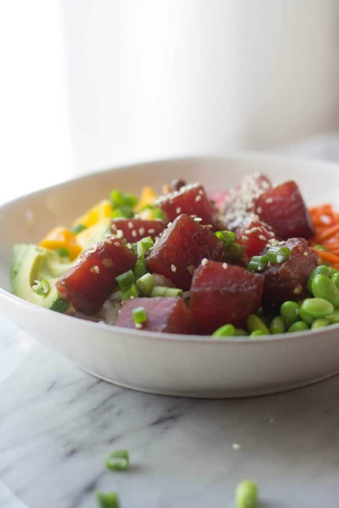 Plated poke bowl with edamame and veggies