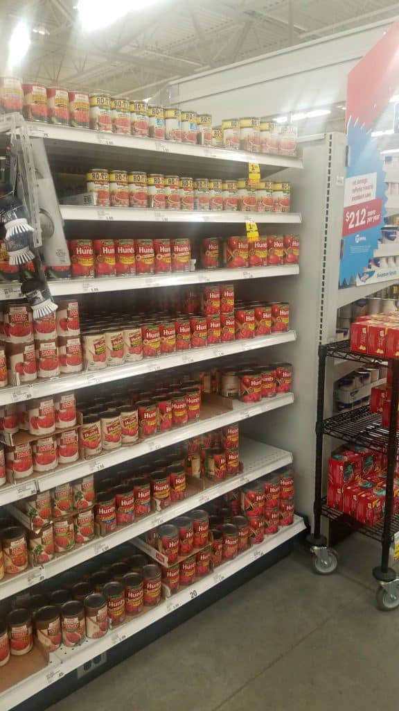 Grocery aisle filled with Hunt's canned tomato products.