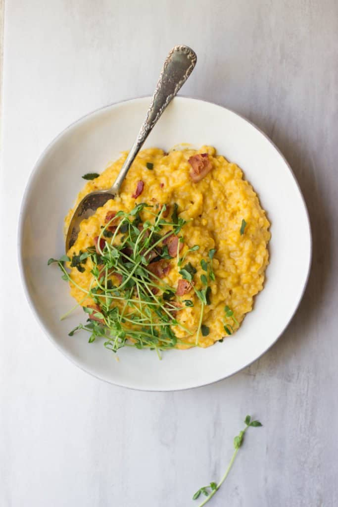 Risotto made with butternut squash and bacon (an overhead shot).