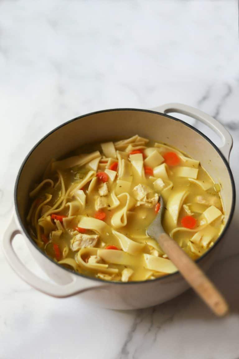 Chicken noodle soup in a pot.