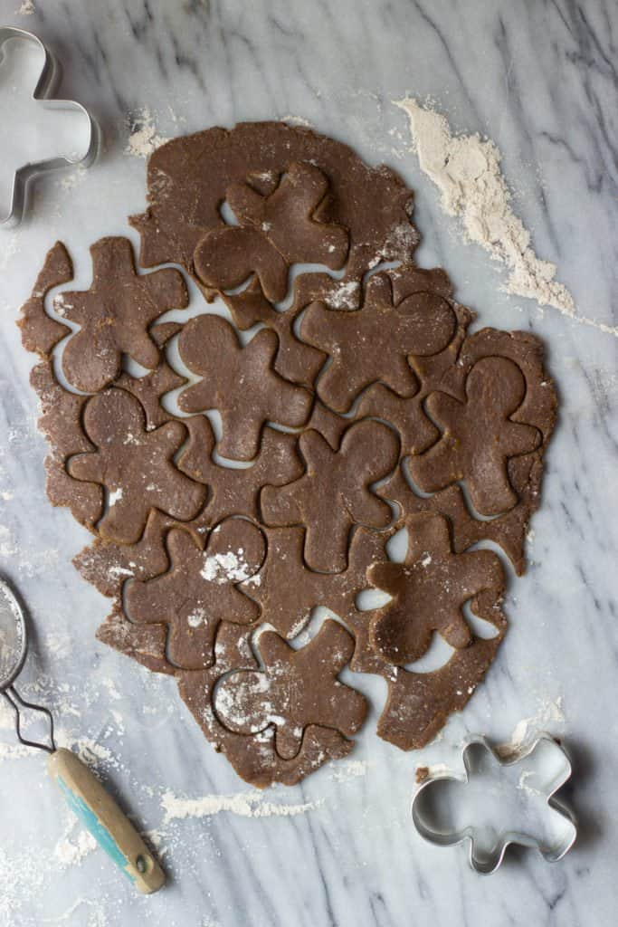 Overhead shot of ginger bread cookies cut after using cookie cutters.