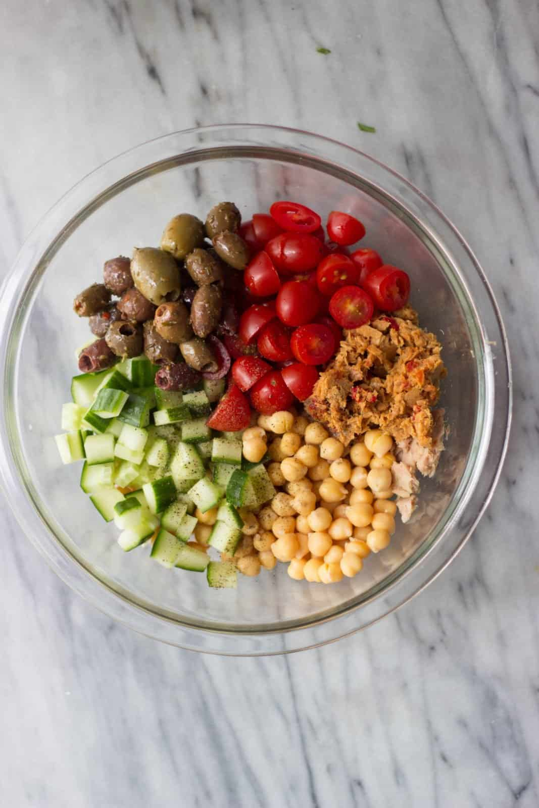 A glass mixing bowl with salad ingredients as a must for setting yourself up for success in the kitchen