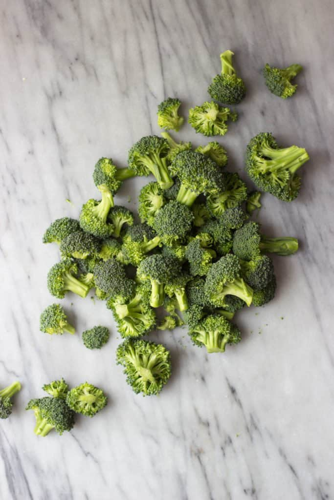 Raw Broccoli florets in a pile.