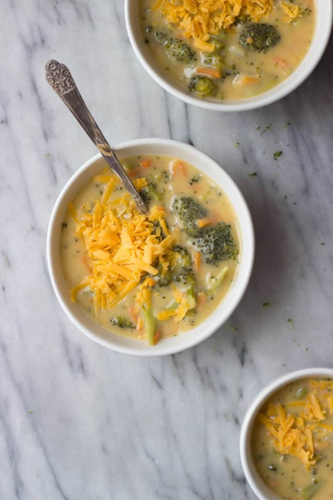 Overhead shot of Broccoli Cheese Soup in a white bowl.