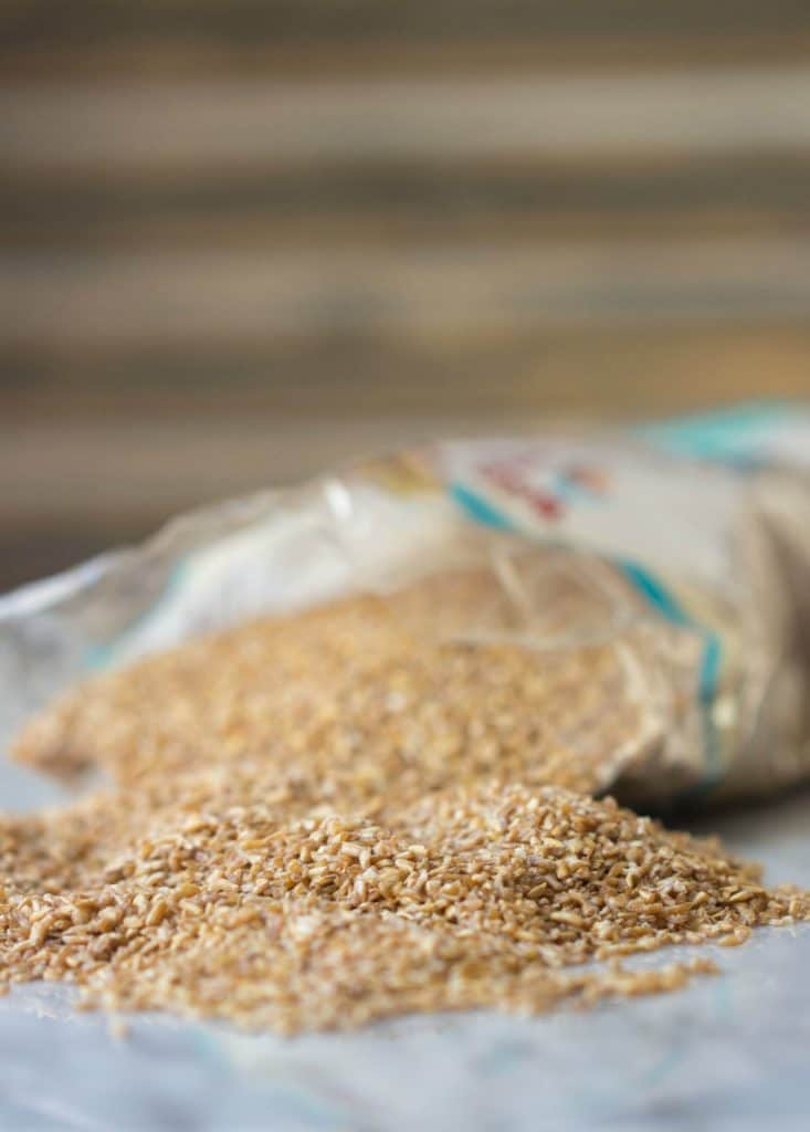 Side view of dry bulgar on countertop with full bag in the background