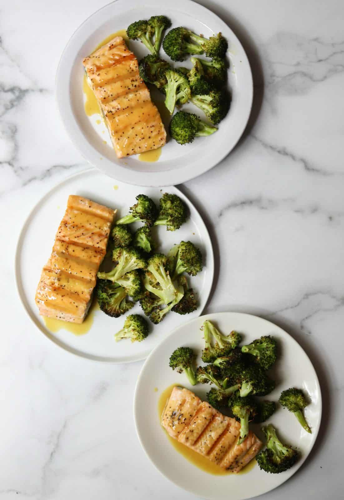 Maple roasted salmon and broccoli on 3 white plates
