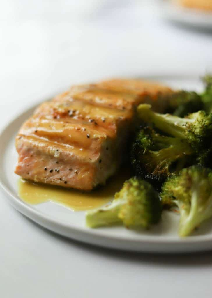 Salmon and broccoli on a white plate