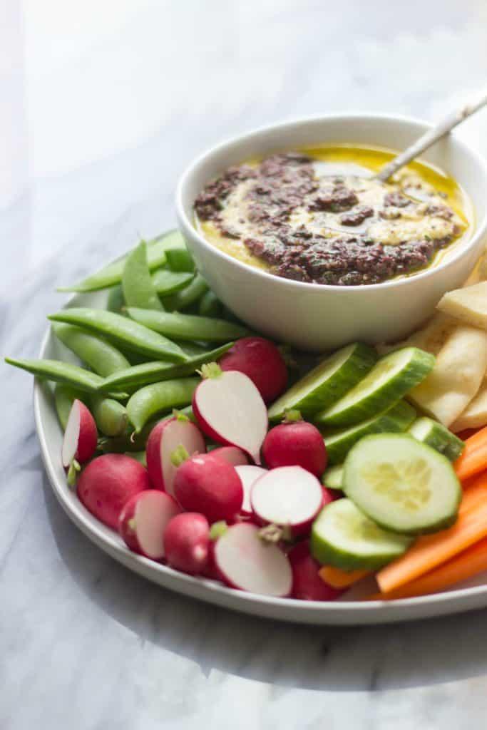 Side shot of Greek Olive Hummus & Crudité Platter