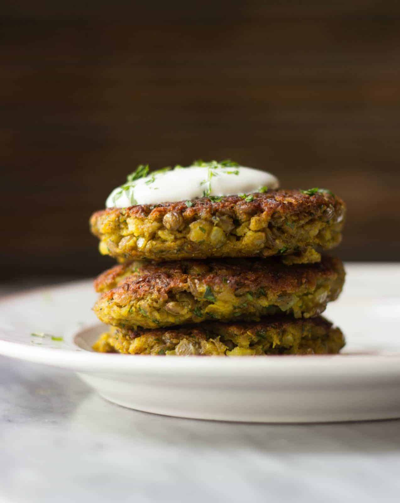 Side shot of 3 stacked curry lentil cakes