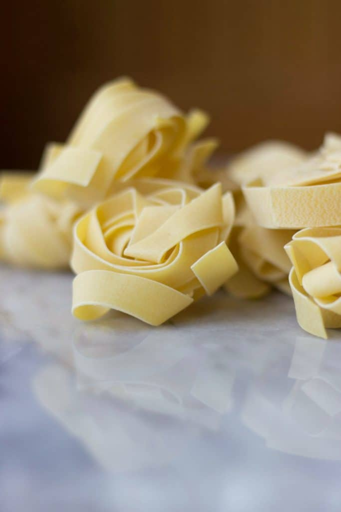 Close-up of Tagliatelle pasta prior to cooking.