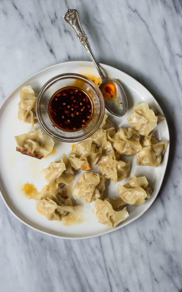 Full plate of Chinese Pork Dumplings with Chili Oil Dipping Sauce