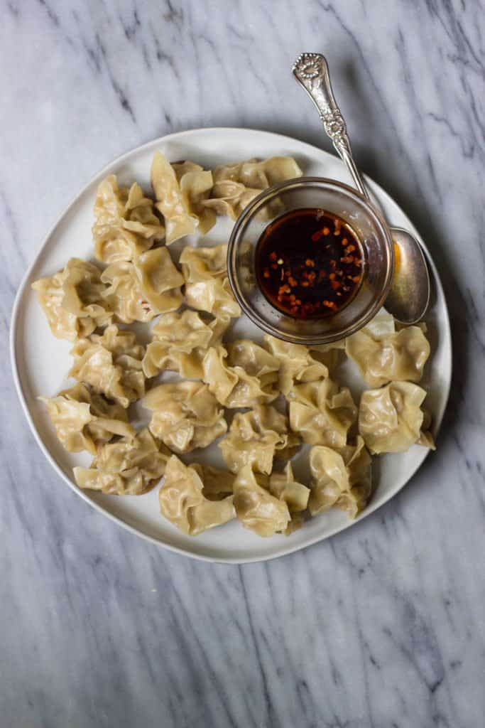 Homemade Chinese Pork Dumplings with Chili Oil Dipping Sauce