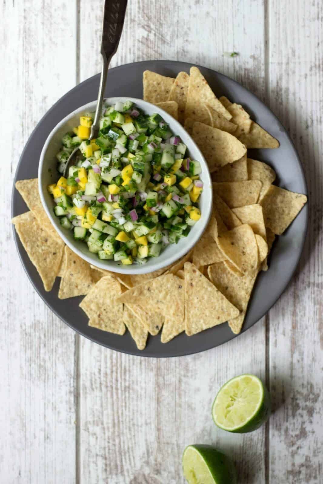 Overhead shot of mango salsa in a bowl with chips.