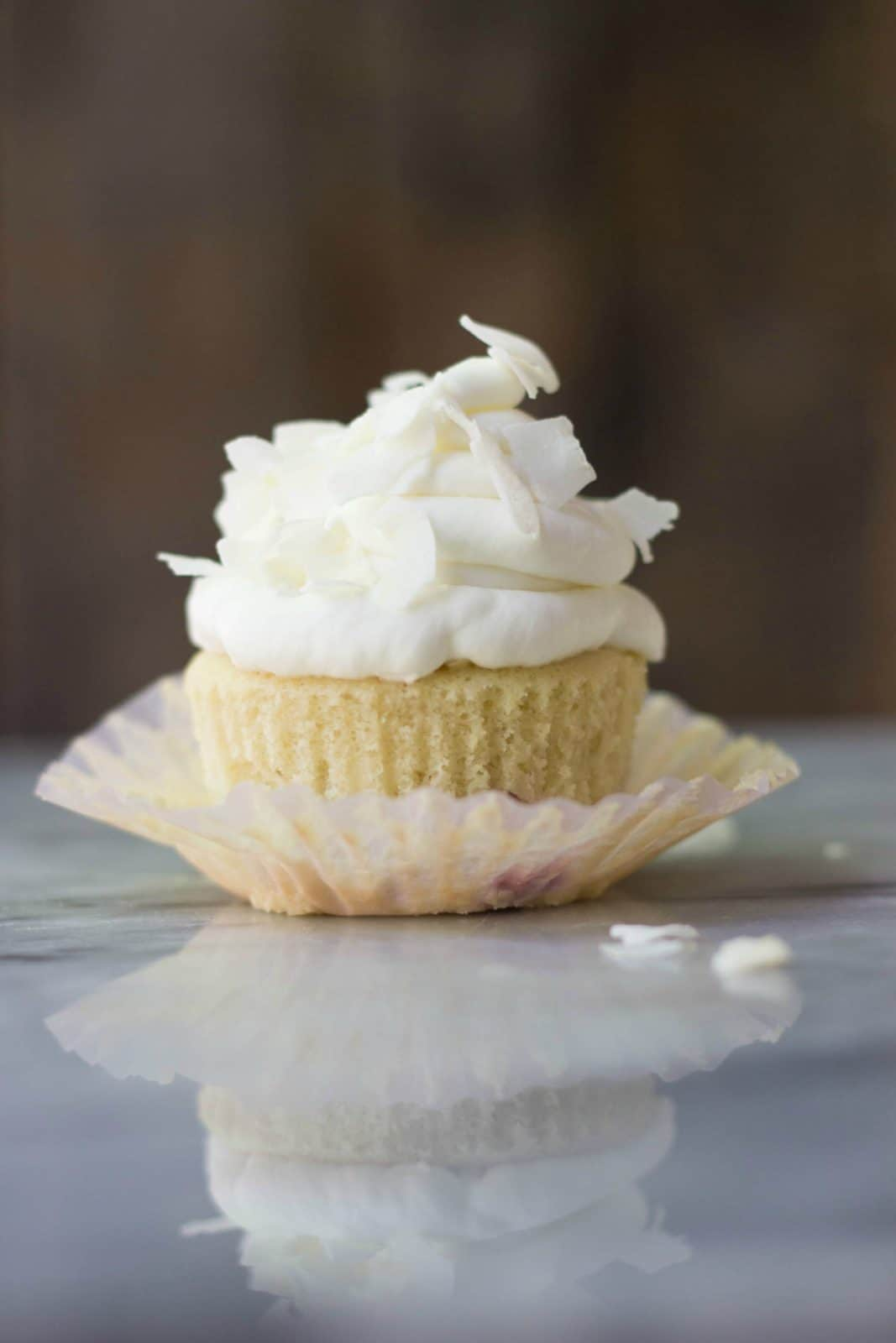 Strawberry Rhubarb Cupcakes with Coconut Milk Frosting on a plate.