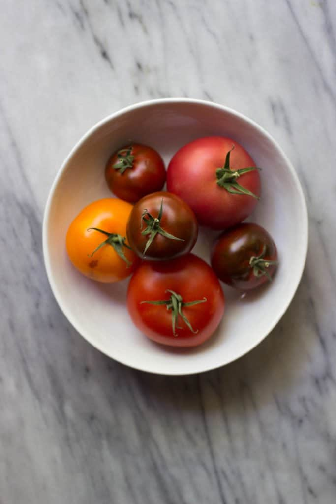 Heirloom Tomatoes on a marble board.