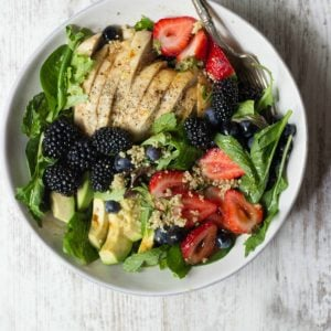 Berry Chicken Salad with Honey Balsamic Vinaigrette in a white bowl.