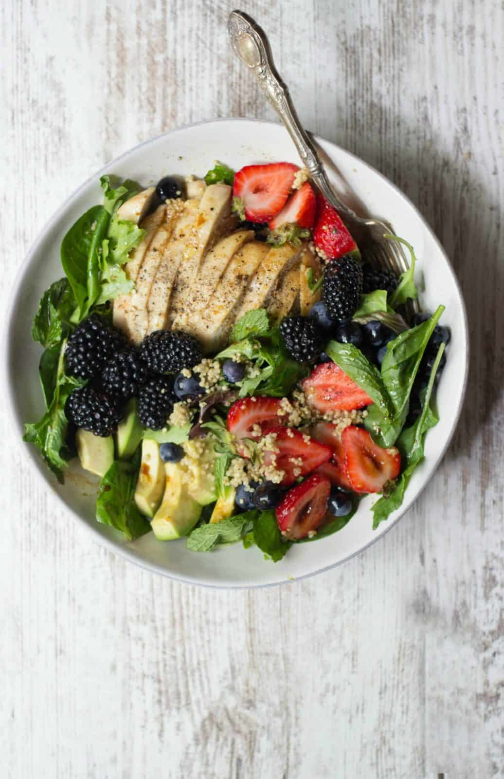 Berry Chicken Salad with Honey Balsamic Vinaigrette in a white bowl (one of the featured summer recipes)
