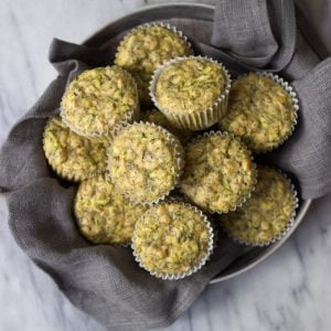 Lemon Poppy Seed Zucchini Muffins in a vintage tin.