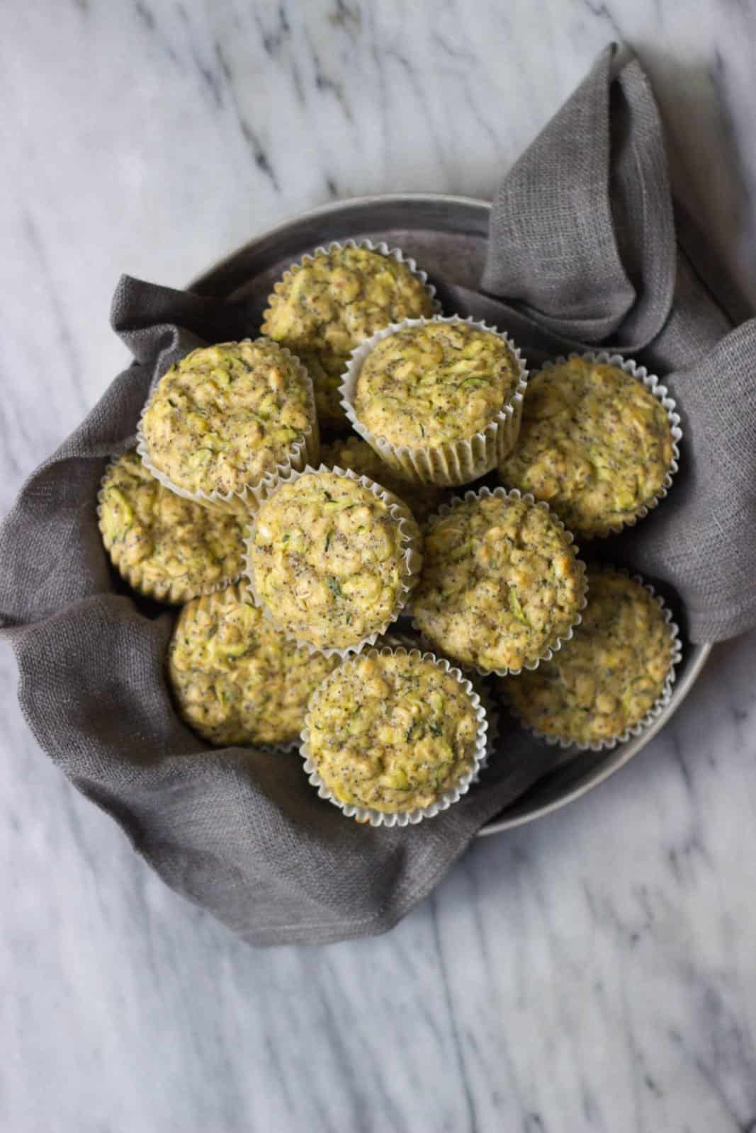 Healthy lemon Poppy Seed Zucchini Muffins in a vintage tin.
