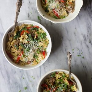 Italian Sausage, Bell Pepper & Spinach Pasta in white bowls.