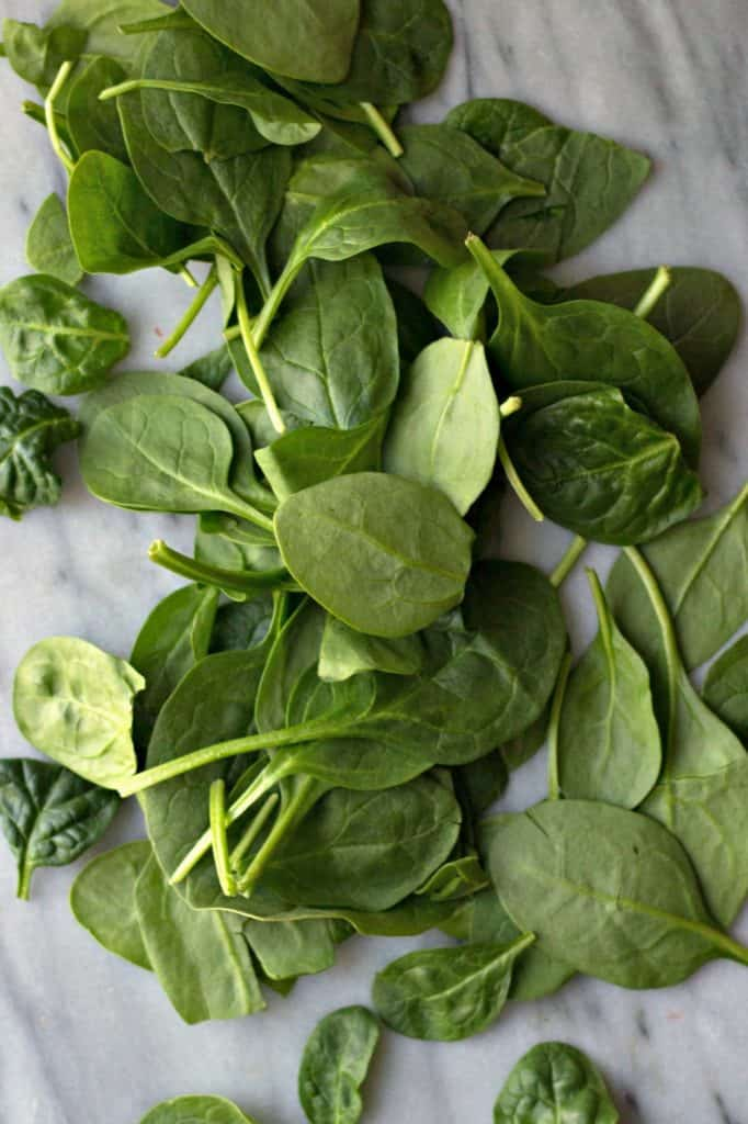 Spinach on a marble board.