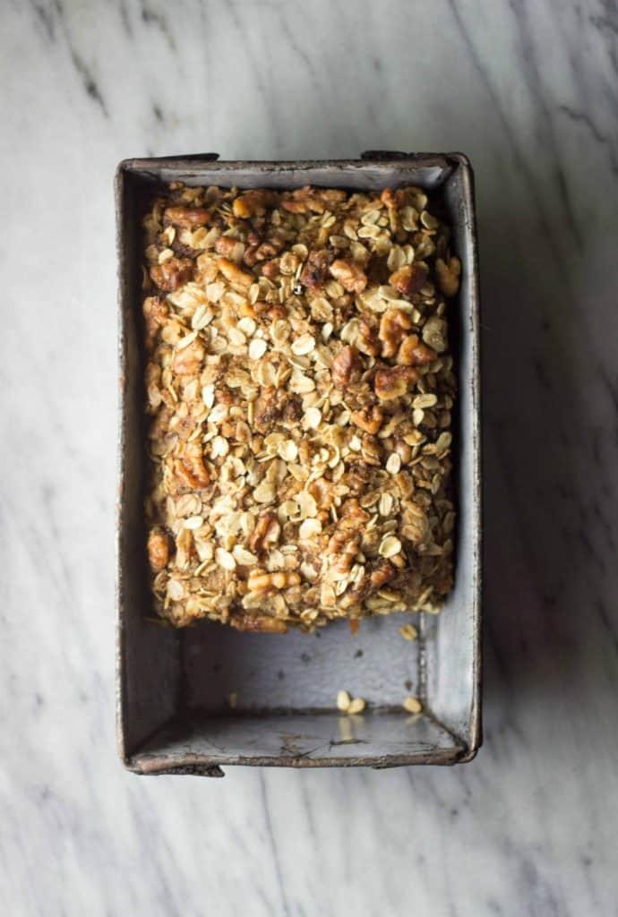 Carrot, Apple & Walnut Streusel Bread in a baking tin