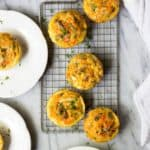 Chorizo & Hash Brown Egg Muffins on plates.