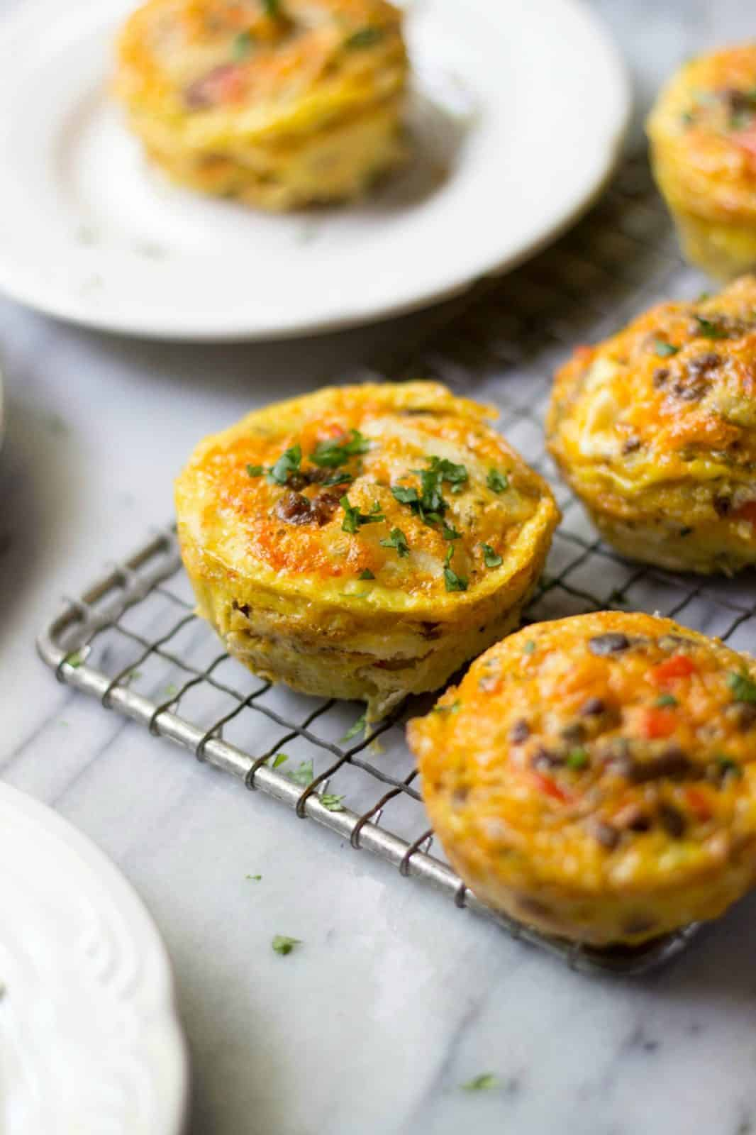 Chorizo & Hash Brown Egg Muffins on a wire rack.
