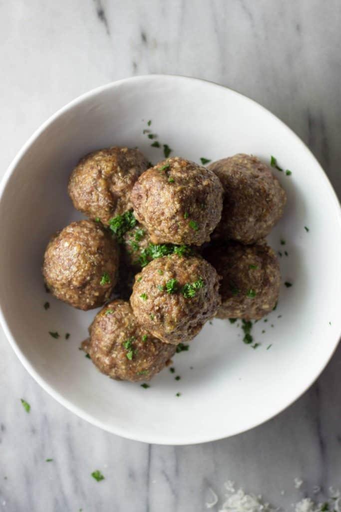 Overhead shot of Italian Meatballs in a White Bowl