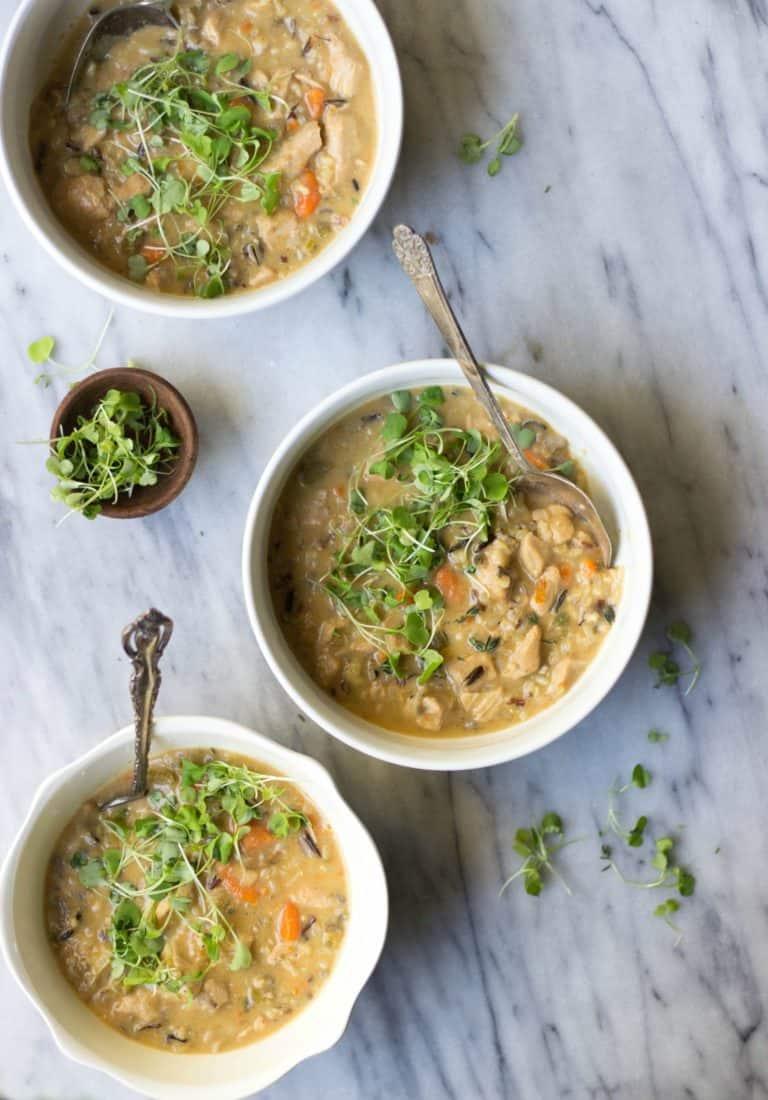Creamy Chicken & Wild Rice Soup in white bowls.