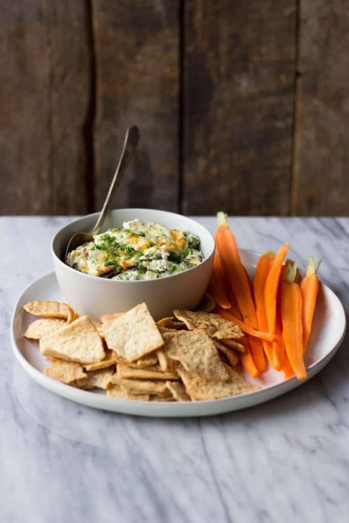 Cheesy Spinach, Artichoke & Bacon Horseradish Dip in bowl.
