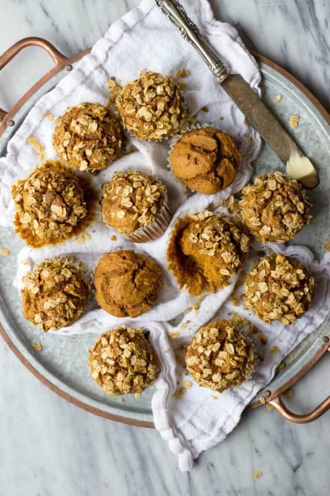 Pumpkin Muffins with Pistachio Crumble on tray.