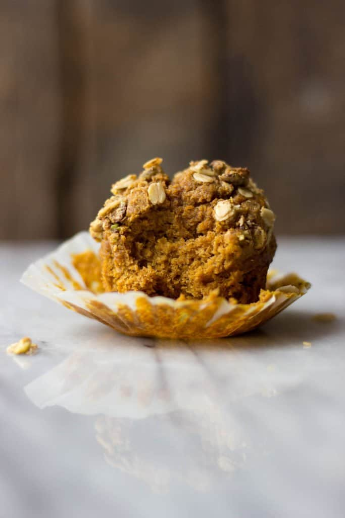 Pumpkin Muffin with Pistachio Crumble on marble.