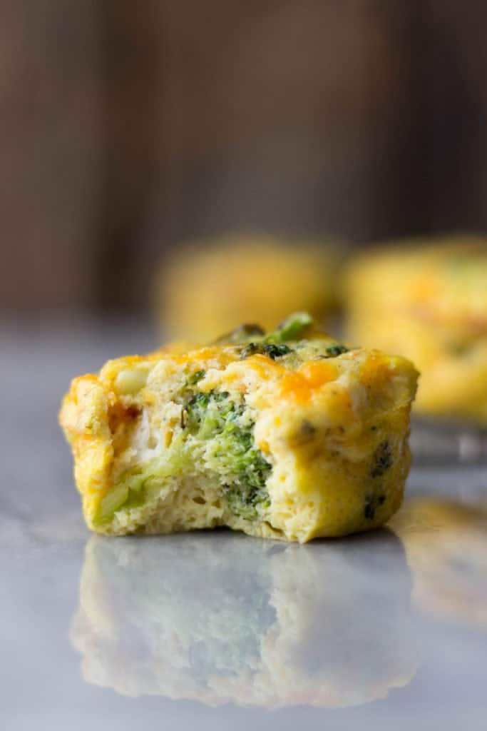 Side shot of Broccoli Cheese Egg Muffin with a bite taken out of it