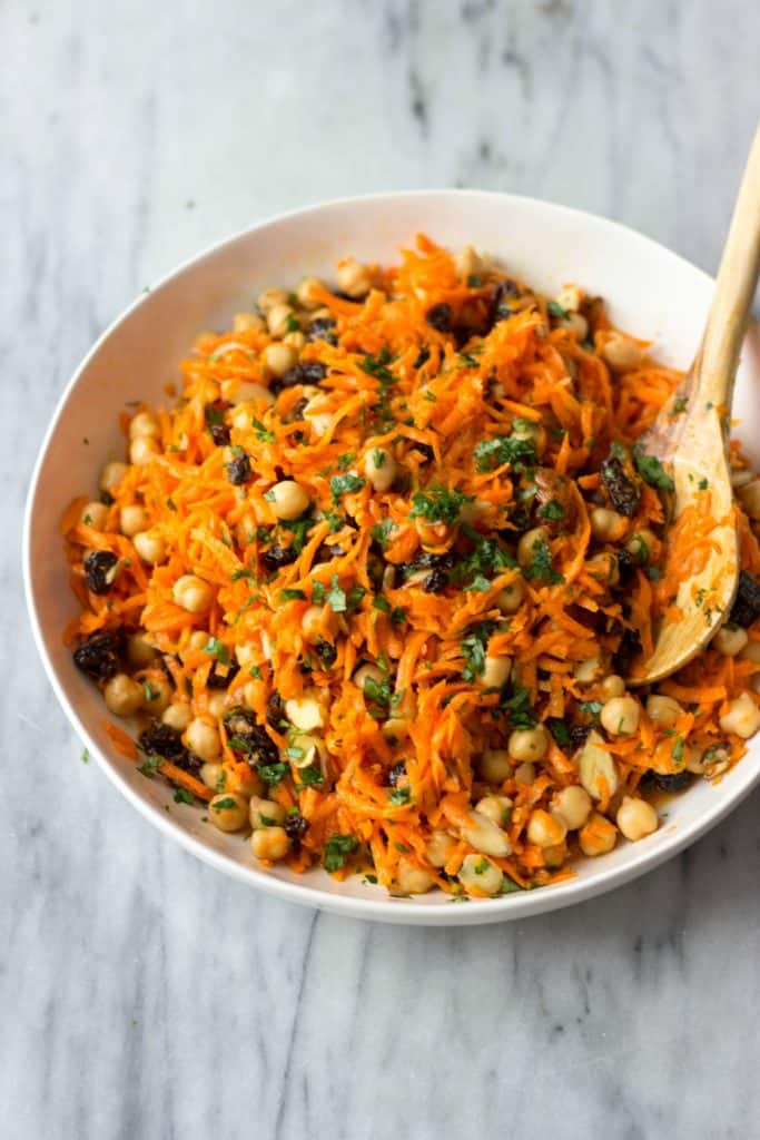 Finished Carrot, Chickpea & Raisin Salad in a white serving bowl