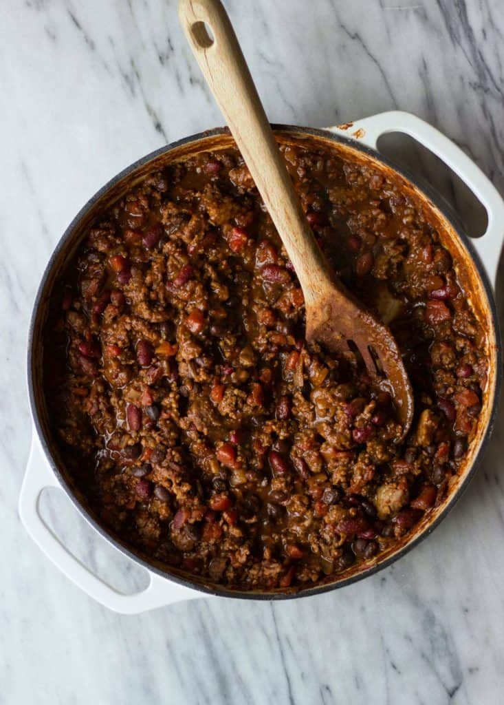 Overhead shot of chili in a white pan