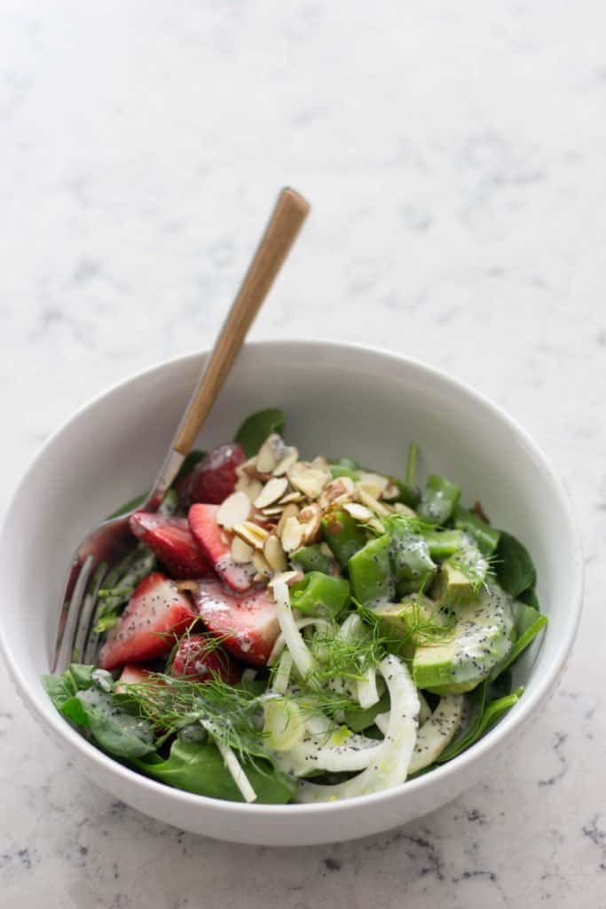 Bowl of spinach, strawberry & fennel salad