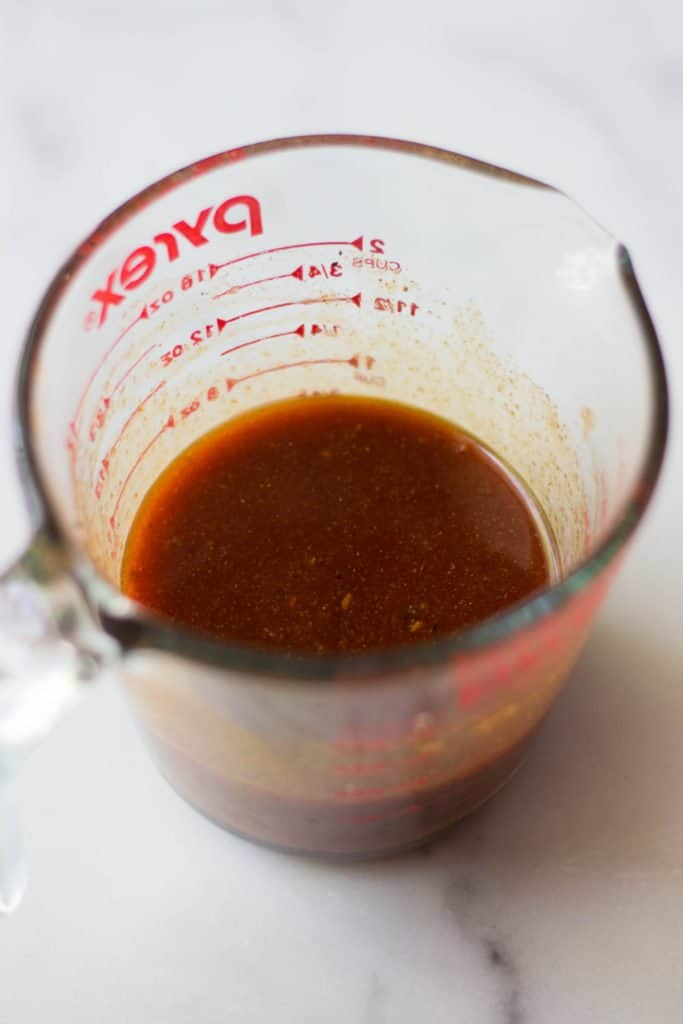 Firecracker sauce in a measuring cup