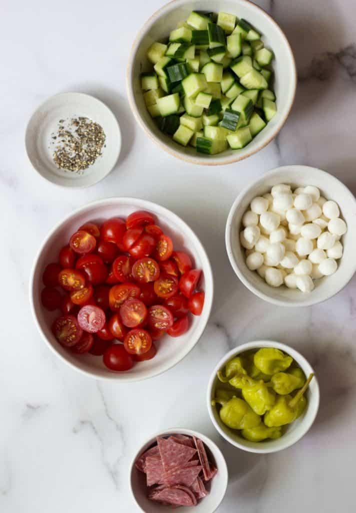 Italian Tortellini Salad Ingredients in white bowls