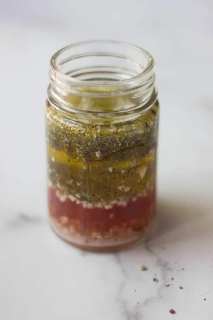 Italian Salad Dressing in a jar as an example of healthy fats in a balanced salad