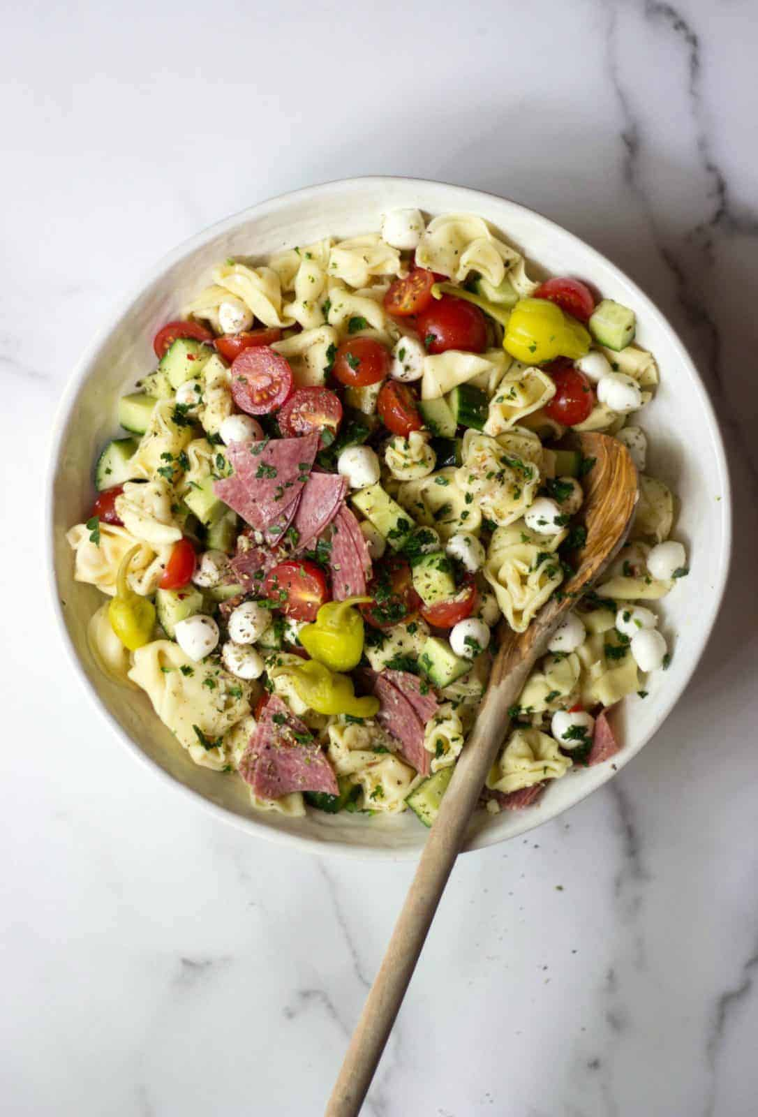 A summer Italian Tortellini Salad in a white bowl