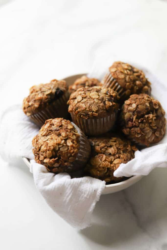 Mixed Berry Crumble Muffins in a basket and white cloth