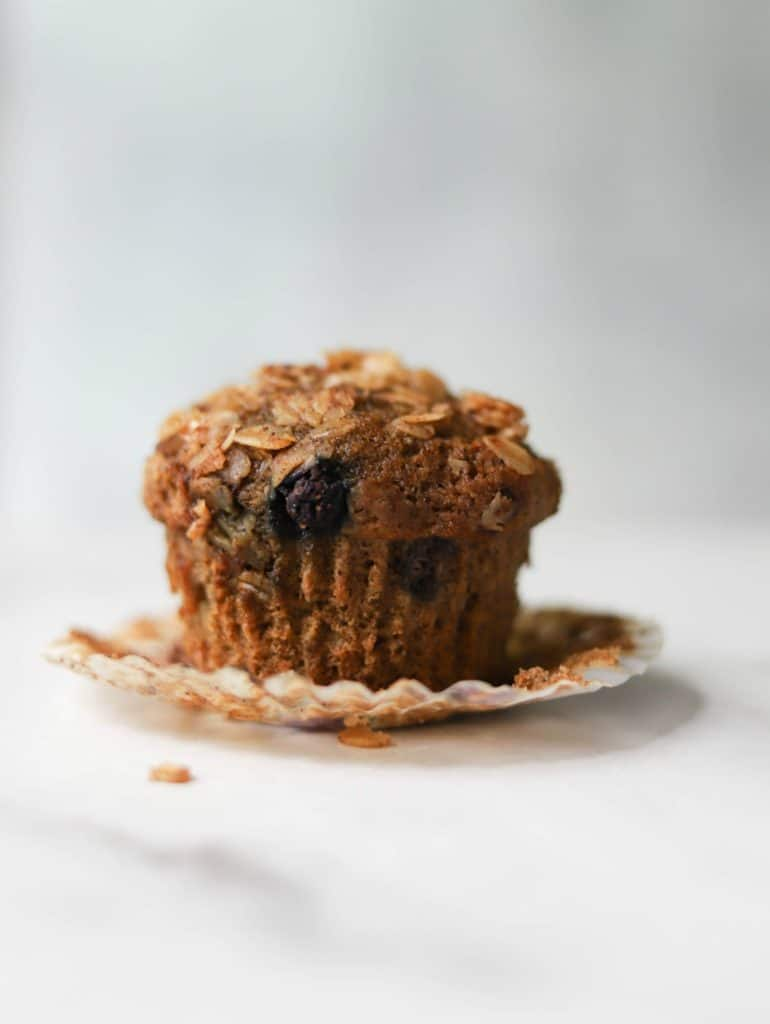 Close up shot of one Mixed Berry Crumble Muffin
