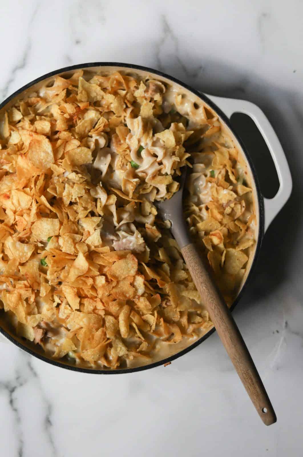 Overhead shot of Tuna Noodle Casserole in a white ceramic dutch oven