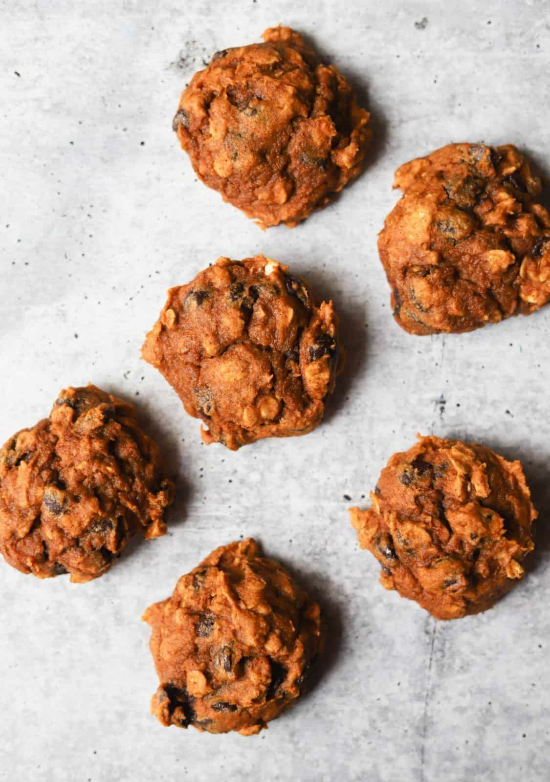 Pumpkin cookies on a grey background