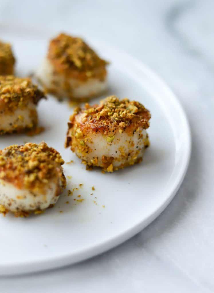 Pistachio Crusted Scallops on white plate