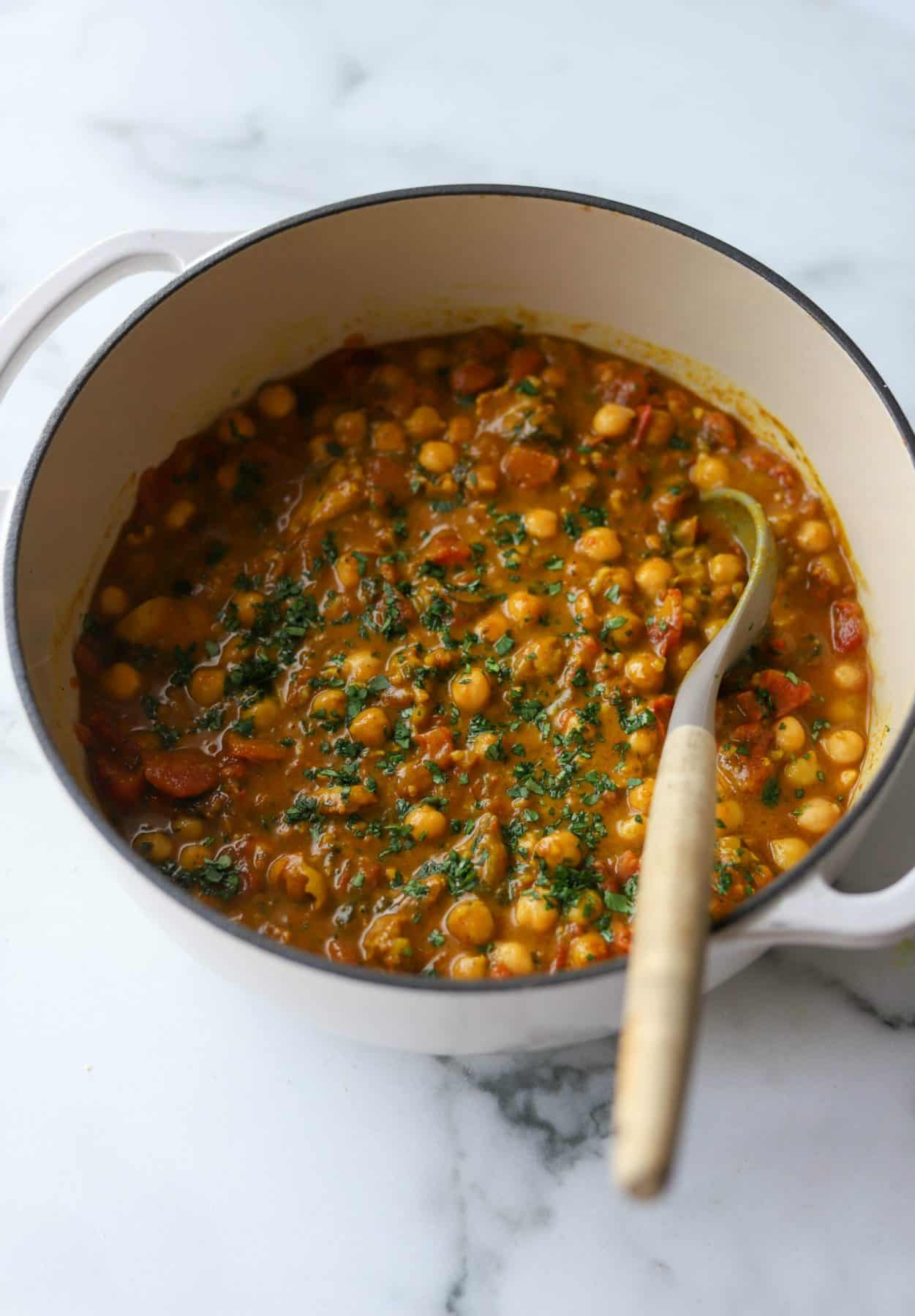 Chickpea curry in a white pot