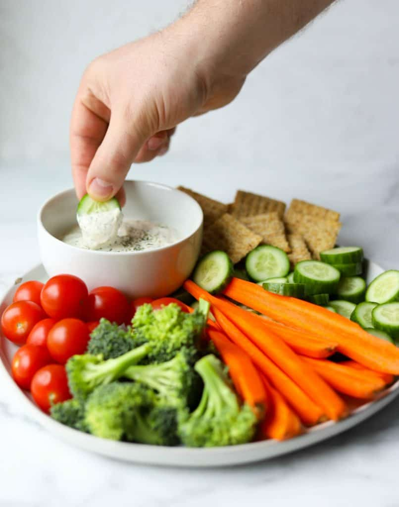 Veggie tray with hand dipping cucumber