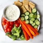 Veggie tray on white marble backdrop